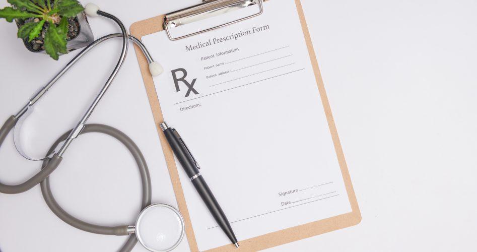Stethoscope, a pen and a blank prescription pad.  Medicine or ph